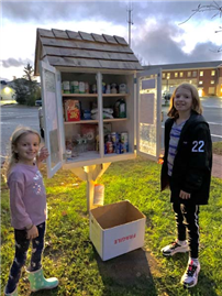 Students pose at the Little Pantry drop-off box thumbnail178997